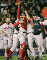 Red Sox Varitek and Embree celebrate winning the ALCS against the Yankees.