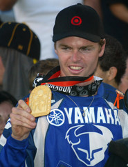 Nate Adams shows his gold medal after victory in Motorcycle final at the X-Games competition in Los Angeles.