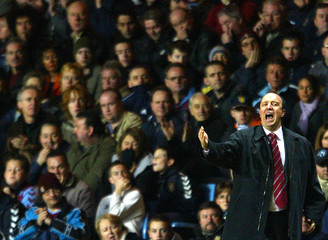 Liverpool's manager Benitez instructs his team during their English Premier League soccer match against ...