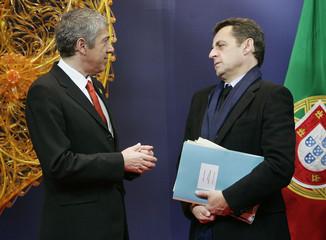 Portugal's PM Socrates talks with France's President Sarkozy at the start of a EU Heads of State and Government summit in Brussels
