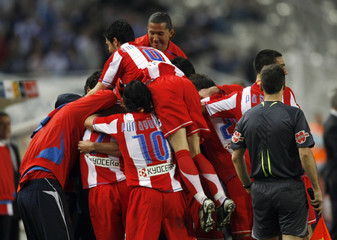 Atletico Madrid's players celebrate a goal against Espanyol during their Spanish First Division Soccer League match in Barcelona