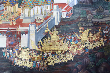 Traditional Thai painting art about Ramayana story on display at the temple wall Wat Prakaew in Bangkok, Thailand.