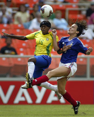 FRANCE'S GEORGES AND BRAZIL'S MAYCON BATTLE FOR THE BALL AT WOMEN'SWORLD CUP.