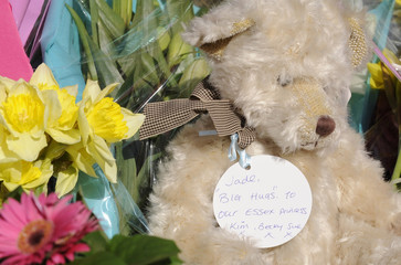 Flowers and a teddy bear with a message are left at the house of Jade Goody in Upshire, Essex, southern England