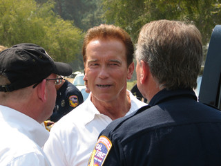 California Governor Arnold Schwarzenegger speaks to an official at La Canada Flintridge