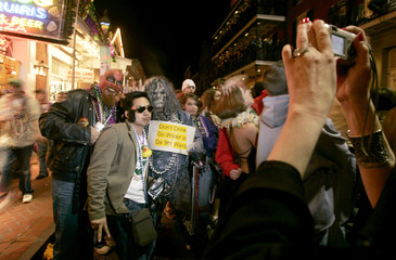 Revelers pose for a photograph in the French quarter of New Orleans