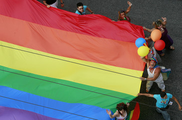 Participants take part in a gay parade in central Athens