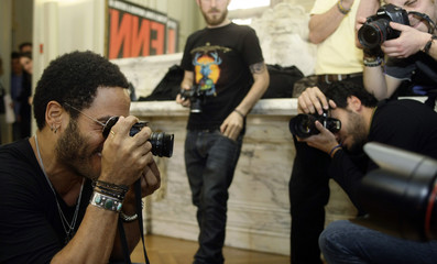 U.S. singer Lenny Kravitz takes photos with his camera during a photo call in Madrid