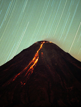 """A 20-minute time exposure showing star patterns and lava flow along Mexico's so-called """"Volcano of F.."""