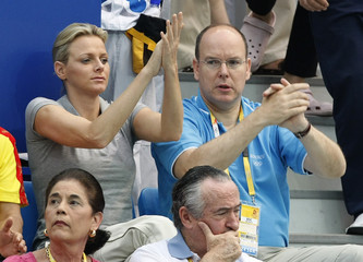 Prince Albert of Monaco and Charlene Wittstock watch the swimming competition at the Beijing 2008 Olympic Games