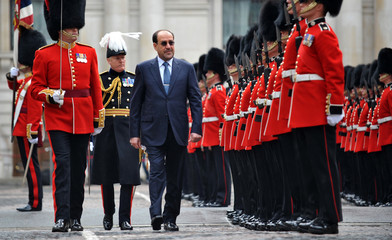 Iraqi Prime Minister Nouri al-Maliki reviews a Guard of Honour ceremony in the quadrangle at the Foreign Office in London