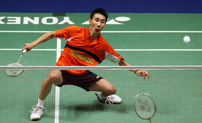 Malaysia's Lee returns a shot to China's Chen during the men's singles quarter-final match at the All England badminton championships in Birmingham