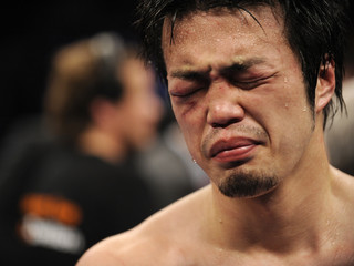 Japan's Sato reacts after being beaten by Germany's Sturm in their WBA middleweight fight in Krefeld