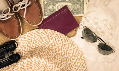 Top view of summer travel accessories and clothing. Vintage tone image.