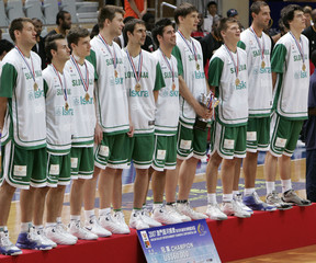 Slovenia team members pose during the trophy presentation ceremony after they won the Continental Cup basketball match in Macau