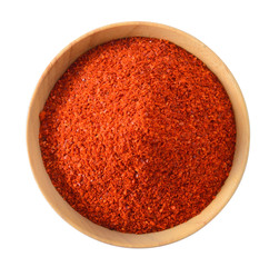 Cayenne pepper in wood bowl on white background