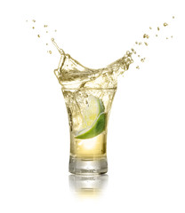 shot of gold tequila with splash