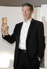 """French actor Vincent Cassel poses with his award for best actor for """"Mesrine"""" (Public Enemy Number One) during the 34th French film Cesar Awards ceremony in Paris"""