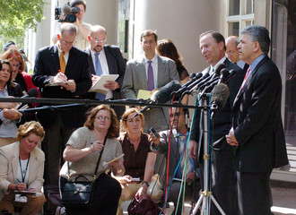 Former Enron CEO Skilling and attorney Petrocelli talk to reporters after conclusion of closing arguments in Houston