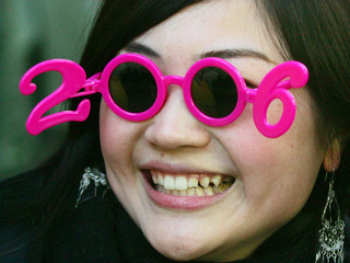 A Japanese girl smiles as she wears a pair of novelty sunglasses in Tokyo