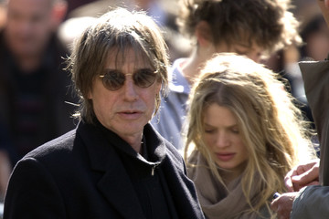 French singer Jean-Louis Aubert and actress Melanie Thierry arrive at the funeral services for French singer Alain Bashung at the Saint-Germain-des-Pres church in Paris