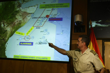 """Spain's General Jaime Dominguez Buj points to a map showing the Indian Ocean area where the Spanish tuna fishing boat """"Alakrana"""" was hijacked, in Madrid"""