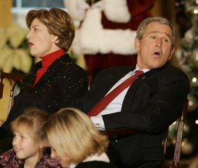 US President Bush and first lady Laura Bush sing jingle bell rock in Washington.