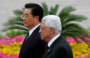 Chinese President Hu and Palestinian President Abbas walk during a welcome ceremony in Beijing.