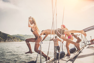Friends on sailing boat Wall mural