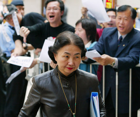HONG KONG SECRETARY FOR JUSTICE ELSIE LEUNG WALKS PAST PROTESTERS INHONG KONG.
