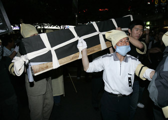 Supporters of deceased former South Korean President Roh carry mock coffin as they march on street during memorial service in Seoul