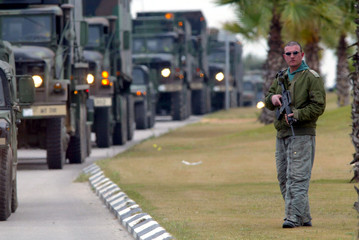 UNDER THE WATCHFUL EYE OF ISRAELI SOLDIERS A CONVOY OF U.S. TROOPSARRIVES AT A MILITARY BASE IN TEL AVIV.