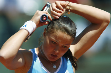 Safina adjusts her hair during her match against Rezai at Roland Garros in Paris