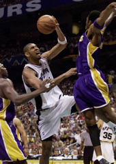 SPURS DUNCAN TRIES FOR SHOT AGAINST LAKERS BRYANT IN SECOND HALF.