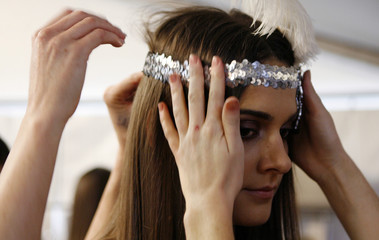 A model is dressed backstage before the start of the Dorian Ho show at the Australian Fashion Week in Sydney