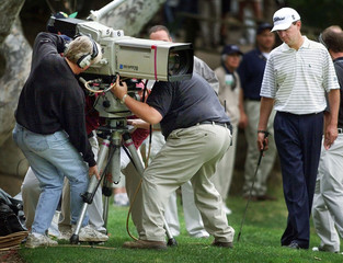 TV CREWS MOVE CAMERA FOR DAVIS LOVE III AT WILLIAMS WORLD CHALLENGE.