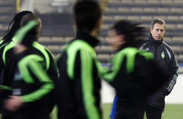 St Etienne's coach Perrin observes training session ahead of their UEFA Cup soccer match against Club Bruges in Bruges