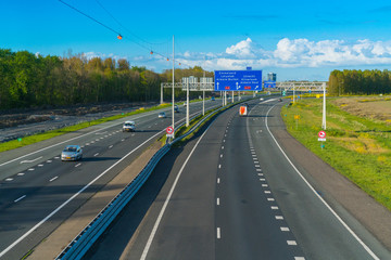 Almere, The Netherlands, April 26, 2016: Cars driving by on the highway A6 between Amsterdam and Lelystad at the Almere Junction