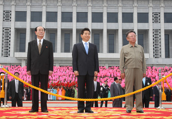 North Korea's no.2 leader Kim Yong-nam, South Korean President Roh Moo-hyun and North Korean leader Kim Jong-il watch the marching of North Korean troops on the podium at a welcome ceremony for Roh in Pyongyang