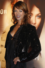 Cast member Schwarz poses for pictures before the premiere of the movie Die Tuer (The Door) in Berlin