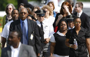 Mourners arrive for the funeral of security guard Stephen T. Johns in Fort Washington