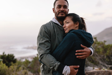 Couple in love embracing in nature
