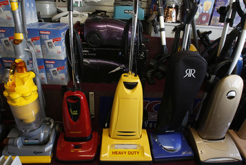 Vacuum cleaners stand on display at a store in Santa Monica