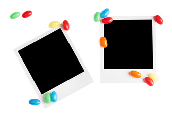 Photo frame with candy isolated on white background