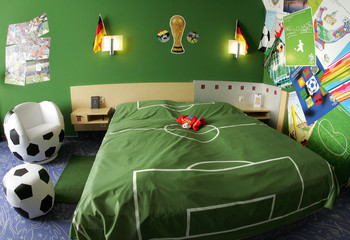 Guest room decorated with soccer accessories is pictured during promotional event at a hotel in Neumuenster