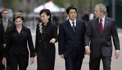 U.S. President Bush, first lady Laura, Japan's PM Abe and his wife Akie walk to White House
