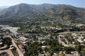 An aerial view shows earthquake-devastated Muzaffarabad, capital of Pakistan-administered Kashmir Oc..