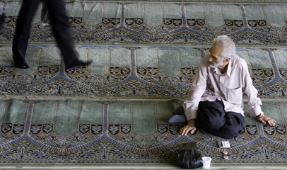Iranian man waits for Friday prayers in Tehran