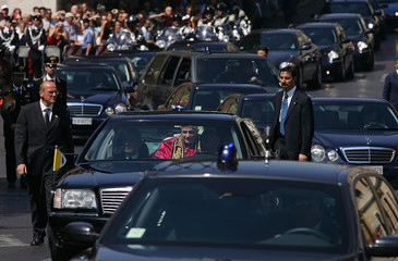 Pope Benedict XVI looks on from his limousine on his way to meet Italy's President Ciampi at ...
