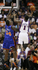 Knicks Curry tries to block a shot by Suns Stoudemire during first quarter NBA basketball action in Phoenix